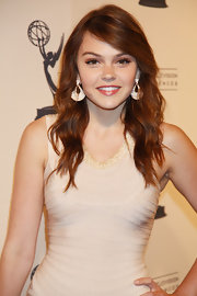 Aimee Teegarden chose a pair of stunning 14k rose gold earrings with diamonds to wear with her fitted, ivory dress.