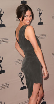 Shelly Henning paired her draped dress with a chic updo.