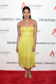 Priyanka Chopra nailed summer glamour in this strapless yellow dress by Jason Wu at the 2016 ACE Awards.