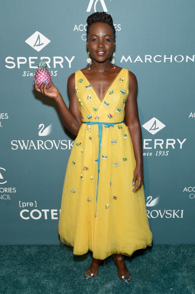 Lupita Nyong'o paired her lovely dress with elegant gold sandals.