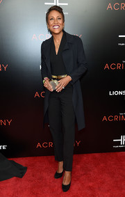 Robin Roberts layered a coat over her jumpsuit for a smarter finish.