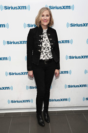 Catherine O'Hara visited the SiriusXM studios looking youthful and edgy in a fitted black toggle jacket.