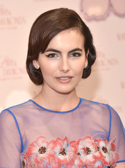 Camilla Belle attended the launch of the Elizabeth Taylor Love & White Diamonds fragrance wearing a vintage-glam faux bob.
