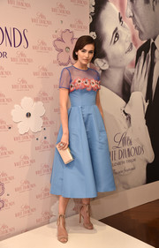 Camilla Belle looked absolutely darling in a sky-blue Carolina Herrera cocktail dress with a sheer yoke and floral accents at the launch of the Elizabeth Taylor Love & White Diamonds fragrance.
