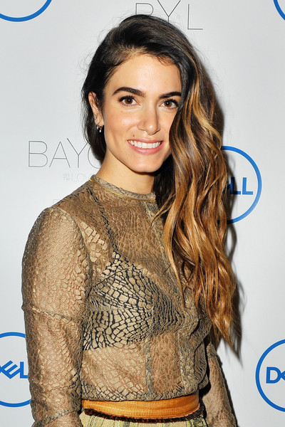 Nikki Reed attended the launch of her jewelry collaboration with Dell wearing glamorous side-swept waves.