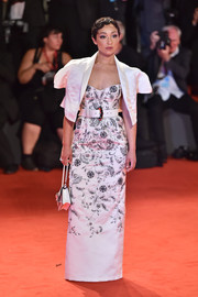 Ruth Negga layered a white bolero over a strapless column dress for the Venice Film Festival screening of 'Ad Astra.'