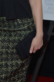 Tina paired a simple black clutch with her red carpet look for a sophisticated look.