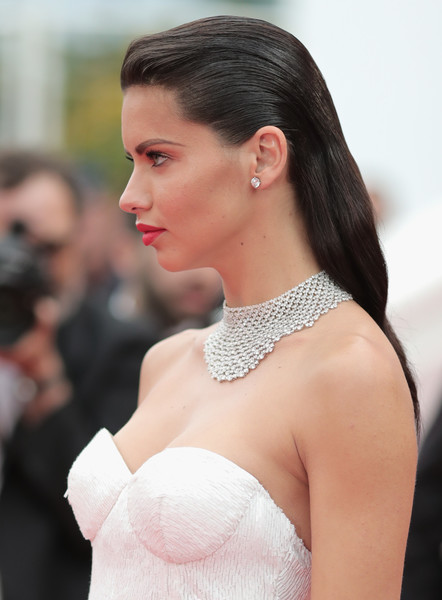 Adriana Lima Diamond Statement Necklace [hair,hairstyle,shoulder,beauty,lip,chin,eyebrow,skin,fashion,chignon,red carpet arrivals,adriana lima,loveless nelyubov,screening,cannes,france,cannes film festival,palais des festivals]