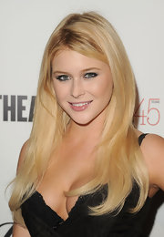 Renee Olstead arrived for the 45th Anniversary celebration of 'The Advocate' wearing her blond hair long and straight.