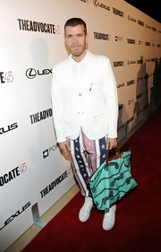 Perez Hilton's star-print pants were a zany contrast to his immaculate top at the Advocate's 45th anniversary.