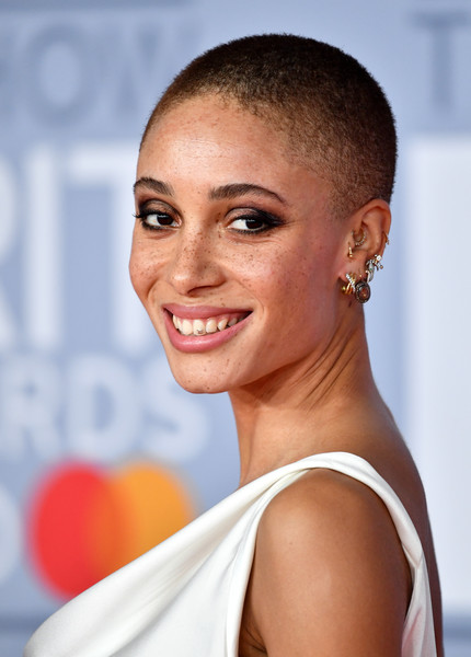 Adwoa Aboah Buzzcut [hair,face,hairstyle,skin,eyebrow,lip,beauty,chin,smile,black hair,red carpet arrivals,adwoa aboah,brit awards,hairstyle,hair,hair,beauty,face,skin,the brit awards 2020,iris law,2020 brit awards,beauty,celebrity,fashion,hair,model,hairstyle,long hair]