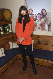 Jameela Jamil sealed off her casual look with black platform boots.