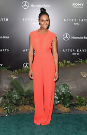 Tika Sumpter chose a peach jumpsuit with a ruffled top for her bright and summery look at the premiere of 'After Earth.'