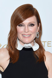 Julianne Moore polished off her look with a pair of diamond hoops by Chopard.