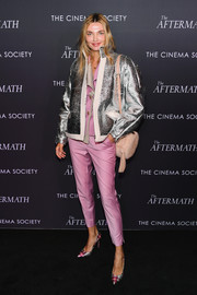 Alina Baikova teamed her jacket with pink cigarette pants and a matching top.