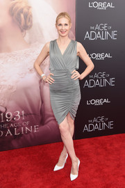 Kelly Rutherford attended the 'Age of Adaline' New York premiere wearing a gray cocktail dress with a hip-hugging shirred skirt.