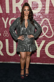 Dascha Polanco completed her outfit with embellished purple platforms.