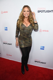 Mariah Carey squeezed her curves into a tiny camo-print dress for the Open Spotlight event.
