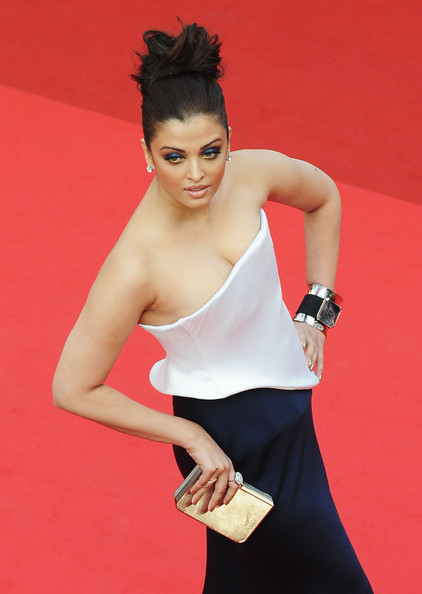 Aishwarya Rai Cuff Bracelet [sleeping beauty,clothing,shoulder,arm,leg,red,beauty,thigh,waist,skin,lady,aishwarya rai bachchan,bollywood,cannes,france,cannes film festival,premiere,palais des festivals]