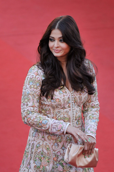 Aishwarya Rai Satin Clutch [blood ties,hair,clothing,fashion model,lady,beauty,hairstyle,fashion,long hair,photo shoot,outerwear,aishwarya rai,premieres,cannes,france,blood ties premiere,cannes film festival,palais des festivals]