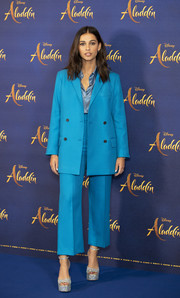 Naomi Scott opted for an aqua-blue blazer and high-waisted pants combo by Paul & Joe when she attended the 'Aladdin' press conference in London.