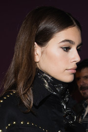 Kaia Gerber wore her hair in a simple center-parted style at the Alberta Ferretti fashion show.