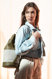 Bella Hadid carried an olive-green and white backpack at the Alberta Ferretti Spring 2019 show.