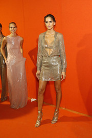 Gold lace-up heels sealed off Izabel Goulart's head-turning attire.