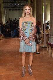 Chiara Ferragni looked enchanting in a strapless, floral-embroidered dress by Alberta Ferretti while attending the label's fashion show.