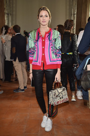Helena Bordon worked loud colors with this printed silk bomber jacket by Gucci at the Alberta Ferretti fashion show.