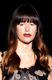 Paz de la Huerta looked unusually tame at the Alberta Ferretti fashion show wearing her hair in sleek waves with neat bangs.