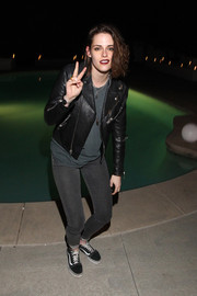 Kristen Stewart completed her edgy attire with black-and-white suede sneakers by Vans.