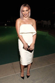 Hilary Duff opted for simple styling with a black Nancy Gonzalez box clutch and a pair of pumps.