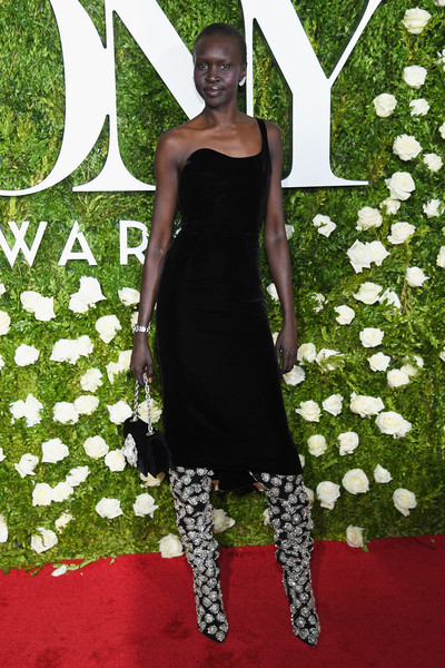 Alek Wek Velvet Bag [little black dress,flooring,fashion model,dress,carpet,fashion,red carpet,shoulder,cocktail dress,catwalk,arrivals,alek wek,tony awards,radio city music hall,new york city]