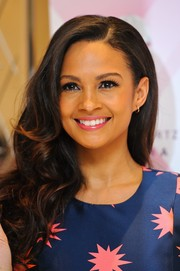 Alesha Dixon wore her hair down in lush curls during the launch of her new fragrance.