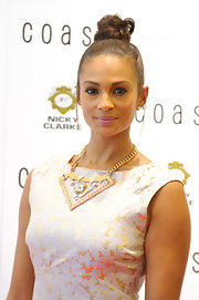 Alesha Dixon topped off her ensemble with an attention-grabbing gold bib necklace during the launch of Coast's new flagship store.