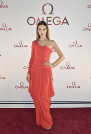 Alessandra Ambrosio looked divine in this red Antonio Berardi gown, featuring a one-shoulder silhouette and a draped skirt, at the Omega Aqua Terra collection celebration.
