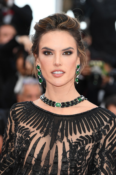 Alessandra Ambrosio Loose Bun [hair,face,hairstyle,fashion model,eyebrow,lip,beauty,fashion,skin,shoulder,red carpet arrivals,alessandra ambrosio,blackkklansman,screening,cannes,france,cannes film festival,palais des festivals]