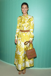 Alessandra Mastronardi paired her frock with a tan satchel, also by Valentino.