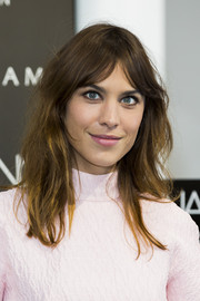 Alexa Chung rocked a disheveled, center-parted hairstyle during the launch of her manicure collection.
