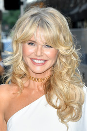 Christie Brinkley got dolled up with this voluminous curly 'do with flippy bangs for the Bella New York beauty cover launch.