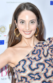A pair of gold hoops with pearl detail completed Alexa Ray Joel's look.