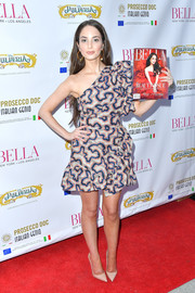 Alexa Ray Joel looked flirty and chic in a printed one-shoulder mini dress at the Bella New York beauty cover launch.
