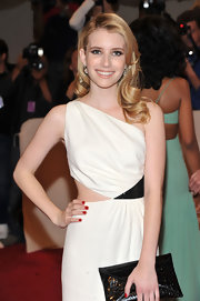 Emma Roberts paired her elegant white dress with ravishing red nail polish at the 2011 Met Gala.