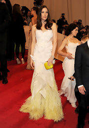 Liv Tyler took flight at the 2011 Met Gala in a white Givenchy Couture gown with a yellow feathered hem.