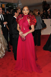 Jennifer Lopez matched her Gucci gown with a fuchsia snakeskin clutch at the 2011 Met Gala.