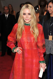 Mary Kate Olsen kept true to her signature look with long center part tresses at the 2011 Met Gala.