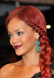 Rihanna spiced up her gorgeous look with a deep burgundy pout at the 2011 Met Gala.