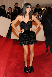 Jessica Szohr differentiated herself on the red carpet at the Met Gala in black platform cutout booties adorned with tassels.