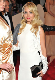 Nicole Richie channeled retro glamour with a stunning black satin vintage clutch encrusted with crystals.